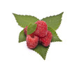 heap of ripe raspberries with leaves