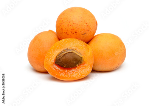 ripe apricots on a white background