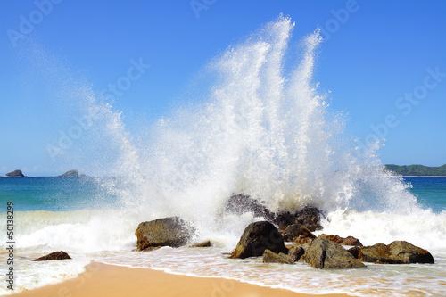 Big wave crashes on to the shore. Nacpan Beach. El Nido