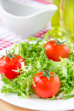 Frizzy crisp lettuce with cherry tomatoes