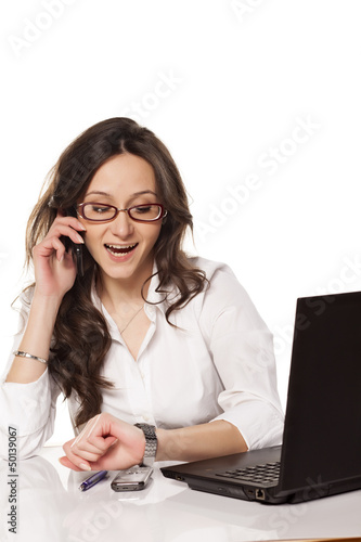 nice and smiling secretary chattering on the phone and looking a