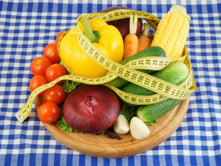 Vegetables with measuring tape, diet concept