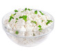 Fresh cottage cheese (curd) in glass bow, isolated on white back