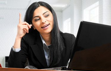 Businesswoman having an idea while working