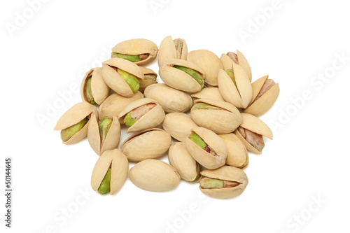 Pile of pistachios on white background