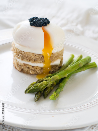 Bread with poached egg with asparagus