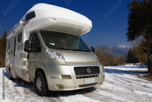 Camper parked on snow in the mountain
