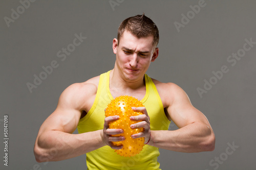 Muscular young man flexing arm muscles