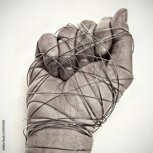 man hand tied with wire