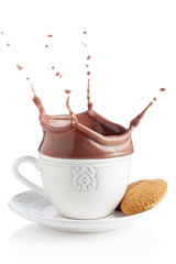 Splash of chocolate in white cup