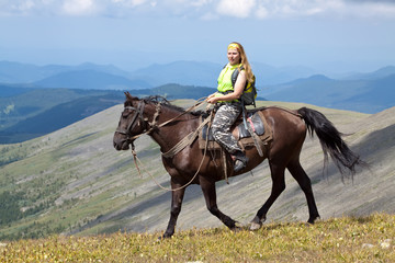 rider with backpack on horseback