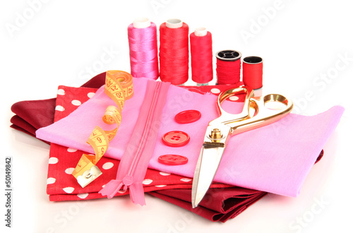 Sewing accessories and fabric isolated on white