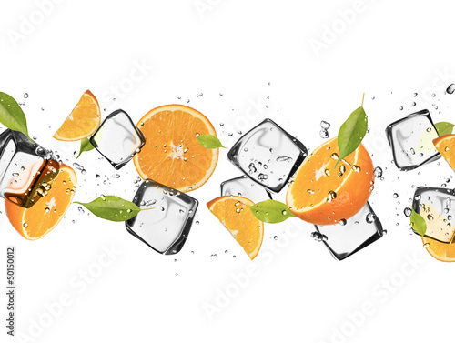 Foto op Canvas In het ijs Oranges with ice cubes, isolated on white background