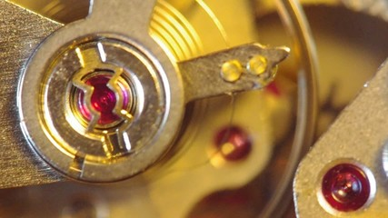 Clockwork of a chronograph. Extreme closeup. Macro