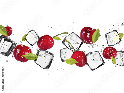 Foto op Canvas In het ijs Fresh cherries with ice cubes, isolated on white background