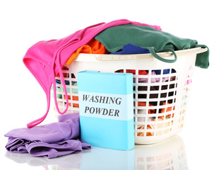 Clothes with washing powder in plastic basket isolated on white