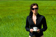 Woman drinking coffee in a field