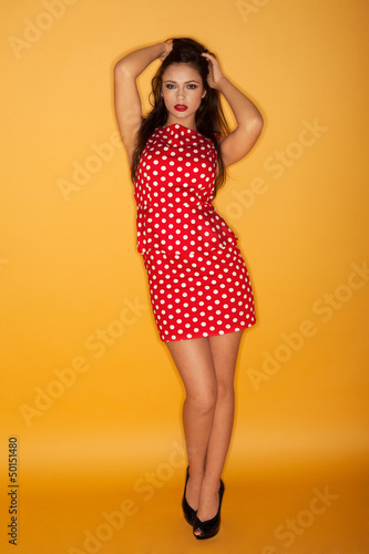 Retro model in a polka dot dress
