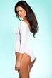 Provocative woman in a white leotard