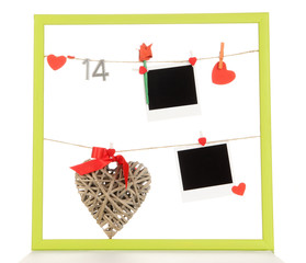 Colorful frame with photos and hearts on rope isolated on white