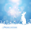 easter background with bunny against a sunny blue sky