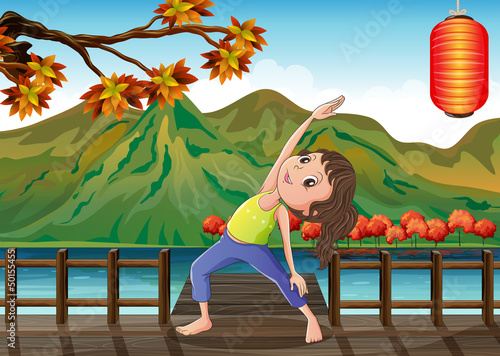 A girl exercising at the bridge with a lantern