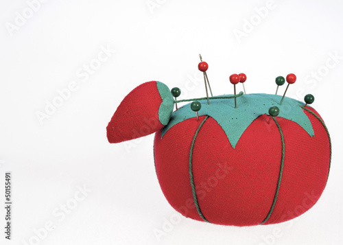red and green pincushion and pins