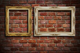Gold frame and White frame hang on old brick wall background