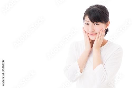 a young asian woman making up