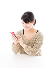 a young asian woman using smart phone