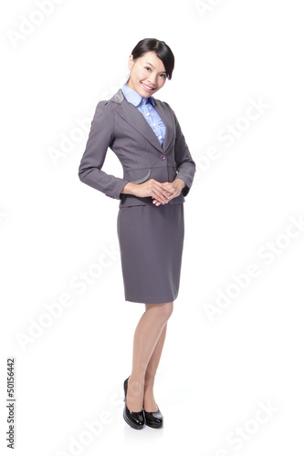 business woman standing and smiling