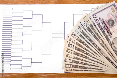 March Madness Bracket and Fanned Money on Right