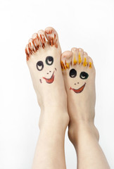 Feet with smiling mugs