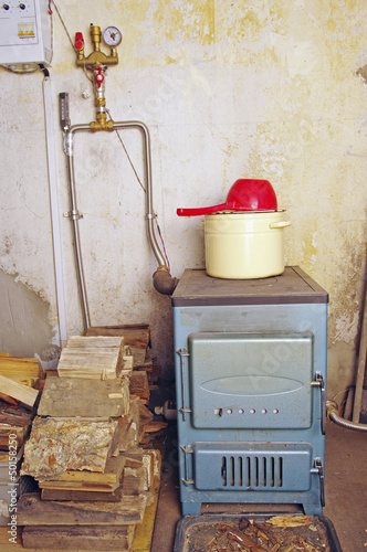 steel water boiler with a stove plate