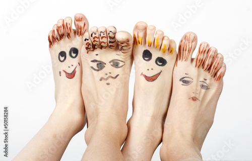 Family. Feet with smiling mugs