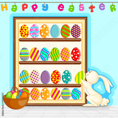 vector illustration of bunny decorating colorful Easter egg