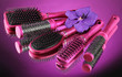 Comb brushes and flower on purple background