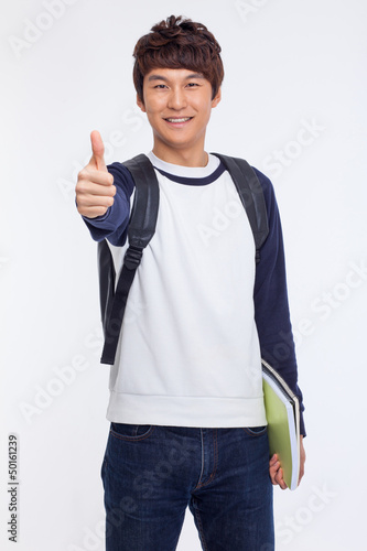 Young Asian student showing thumb