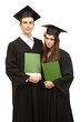 Two happy graduating students holding graduation certificate