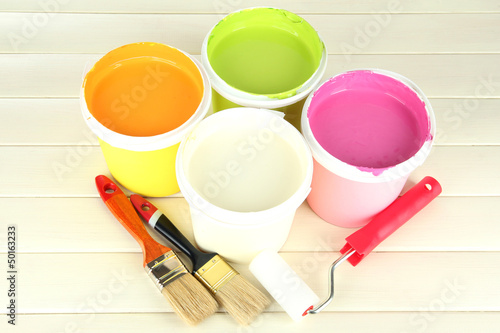 Set for painting: paint pots, brushes, paint-roller