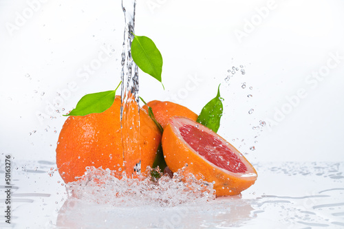 water splash in kiwi fruit isolated on white bacground