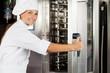 Female Chef Opening Oven Door