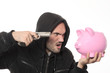 man with gun and pink piggy bank