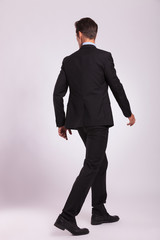 back view of business man walking
