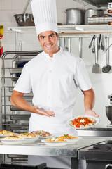 Male Chef Presenting Pasta Dish