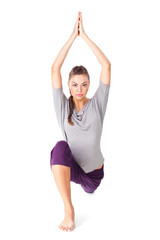 Young woman doing yoga exercise low lunge