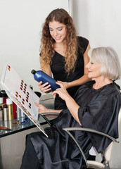 Client And Hairdresser Choosing Hair Color