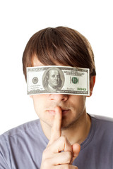 Young man with eyes sealed by a hundred dollar bills