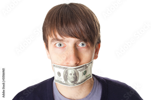 Portrait of young man with a 100 dollar banknote on his mouth is