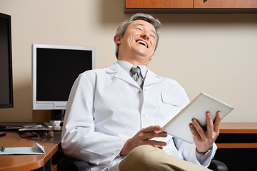Cheerful Doctor Holding Digital Tablet